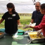 Volunteers serving free food to the walkers